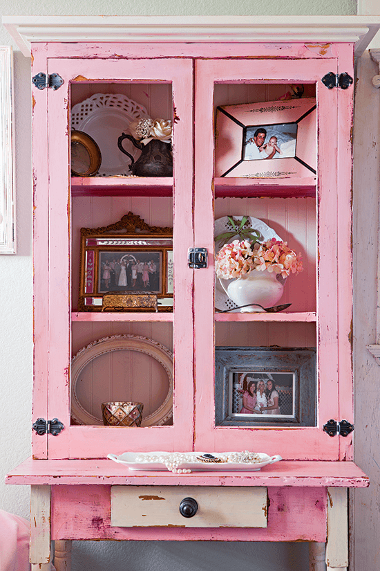 The pink cupboard was a thrift-store purchase for the wedding, which now houses ironstone and milk glass.