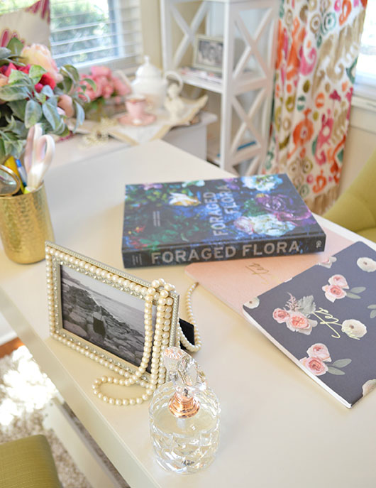 foraged flora book and pearls on a desktop
