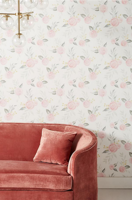 floral wallpaper, modern gold light fixture and blush velvet couch