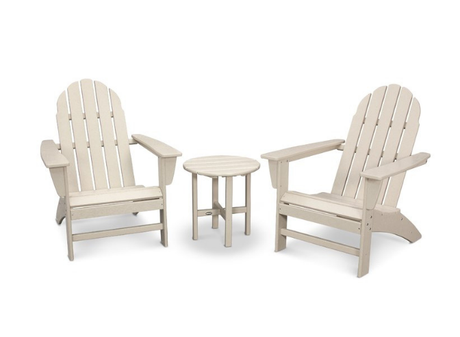 set of 2 cream colored Adirondack chairs with small table