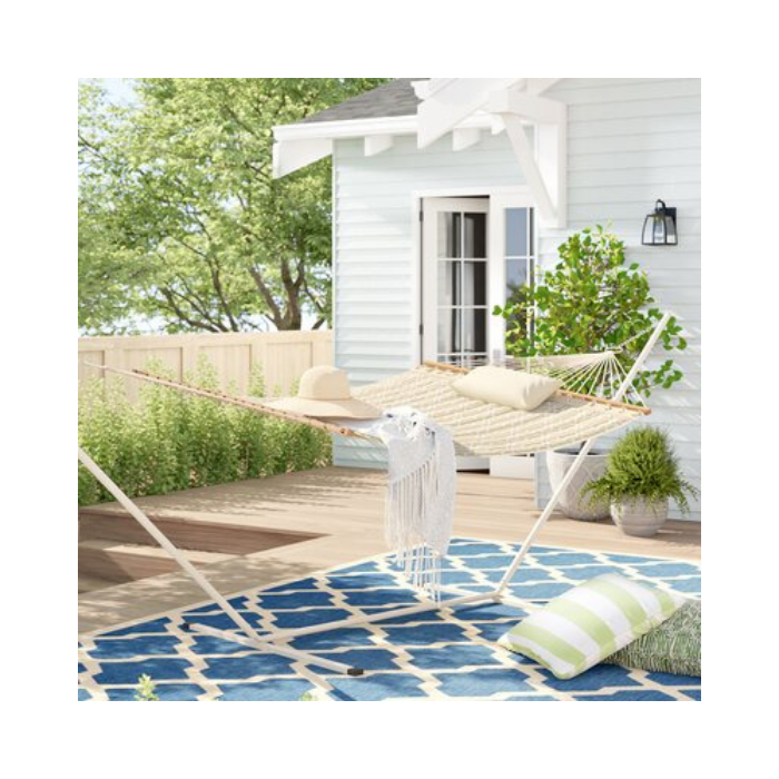 patio with blue and green accents and white hammock