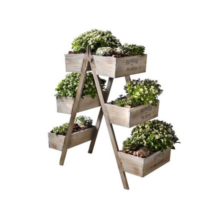 wooden layered planter boxes filled with green plants