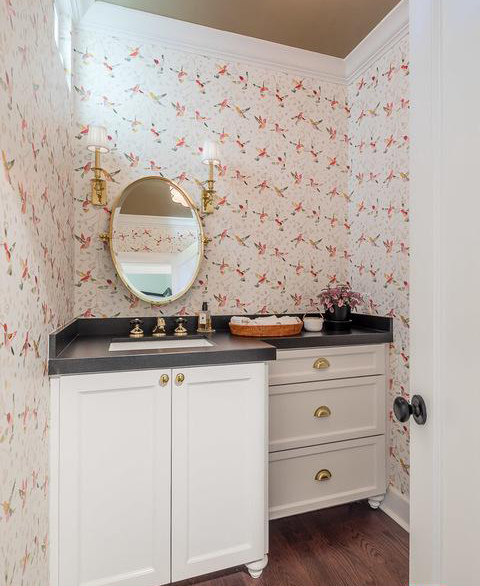 small powder room with hummingbird wallpaper