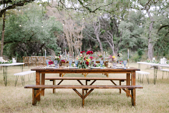 outdoor picnic table with floral table setting and candles