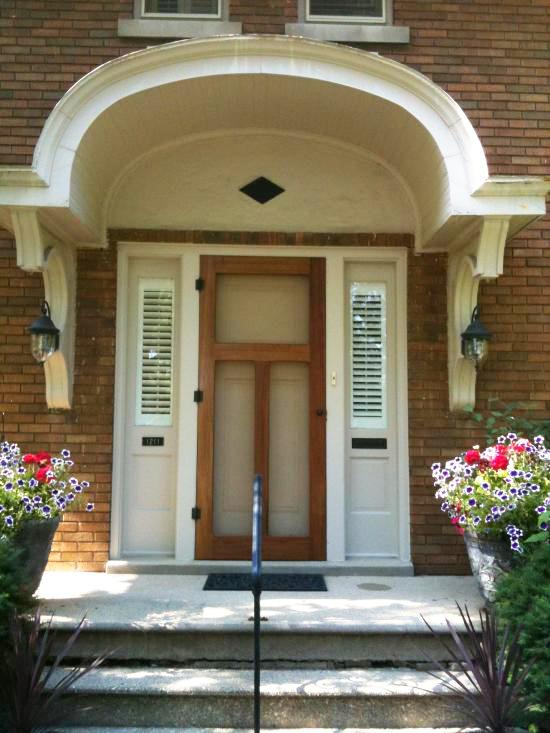 arched portico with vintage door