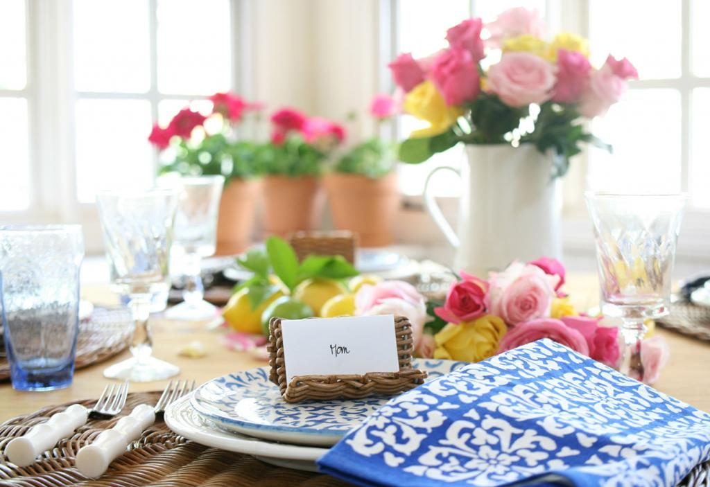 blue and white napkins and a wicker place card setting