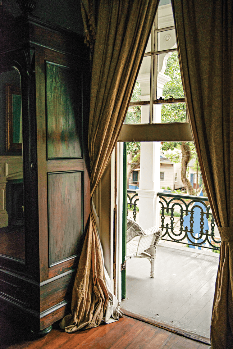 large window with heavy curtains in the Degas house