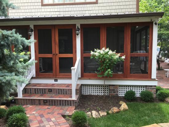 double gardenia screened-in porch front view // vintage doors