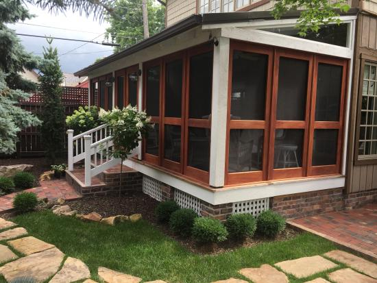 double gardenia screened-in porch side view // vintage doors