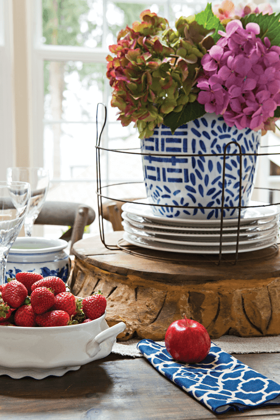 blue and white pot on a farmhouse style dining table