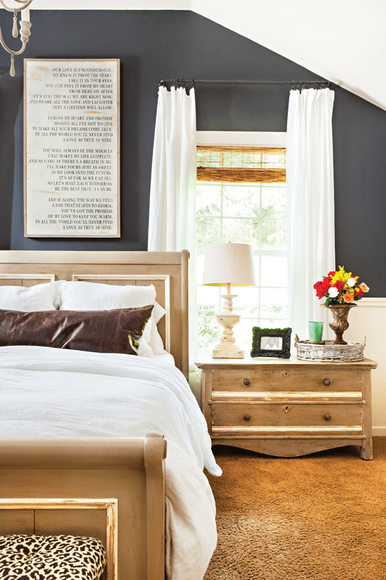 farmhouse bed and nightstand with word art above the bed
