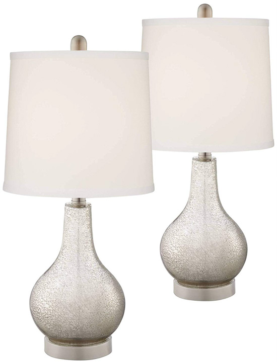 Set of two bedside lamps with mercury glass base and USB ports.