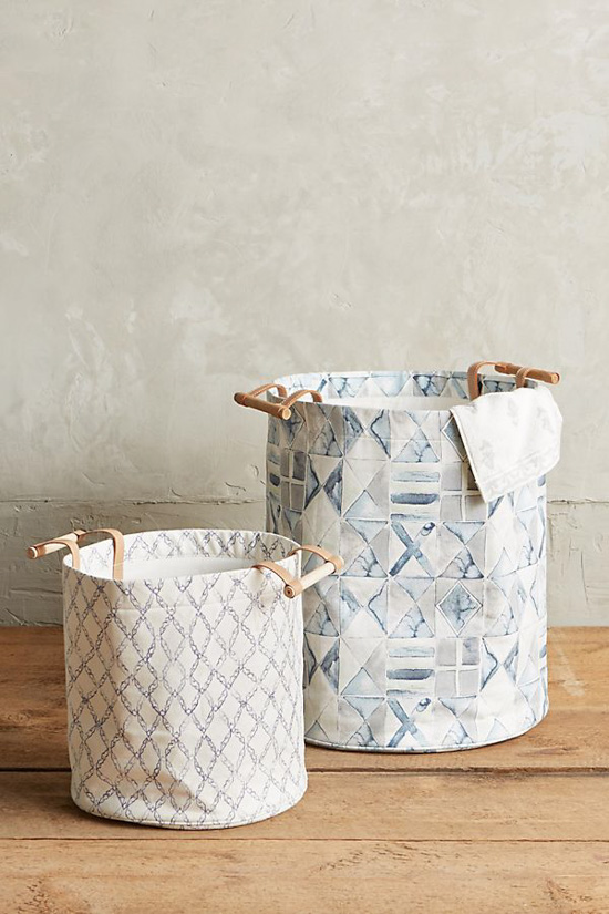 Set of two watercolored light shades of blue hampers in two different sizes.