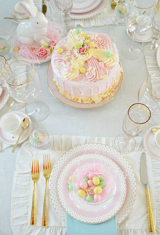 elegant table with easter cake and pretty china