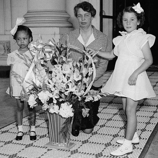Eleanor Roosevelt and some young girls that delivered a May Day Basket to the White Houe.