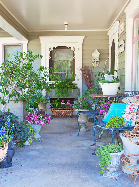 Creative containers make the porch garden a whimsical and colorful space.