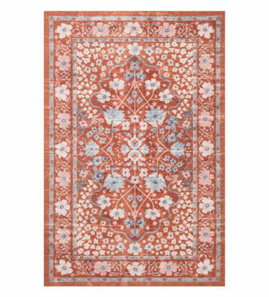 Rust colored Persian style rug with light white and blue floral design.