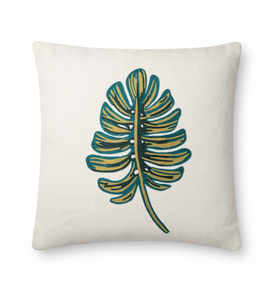 White pillow with a green botanical garden leaf.