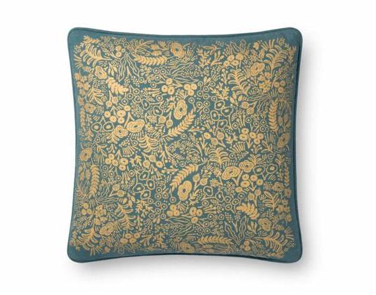Teal colored pillow with gold embossed florals across the front.