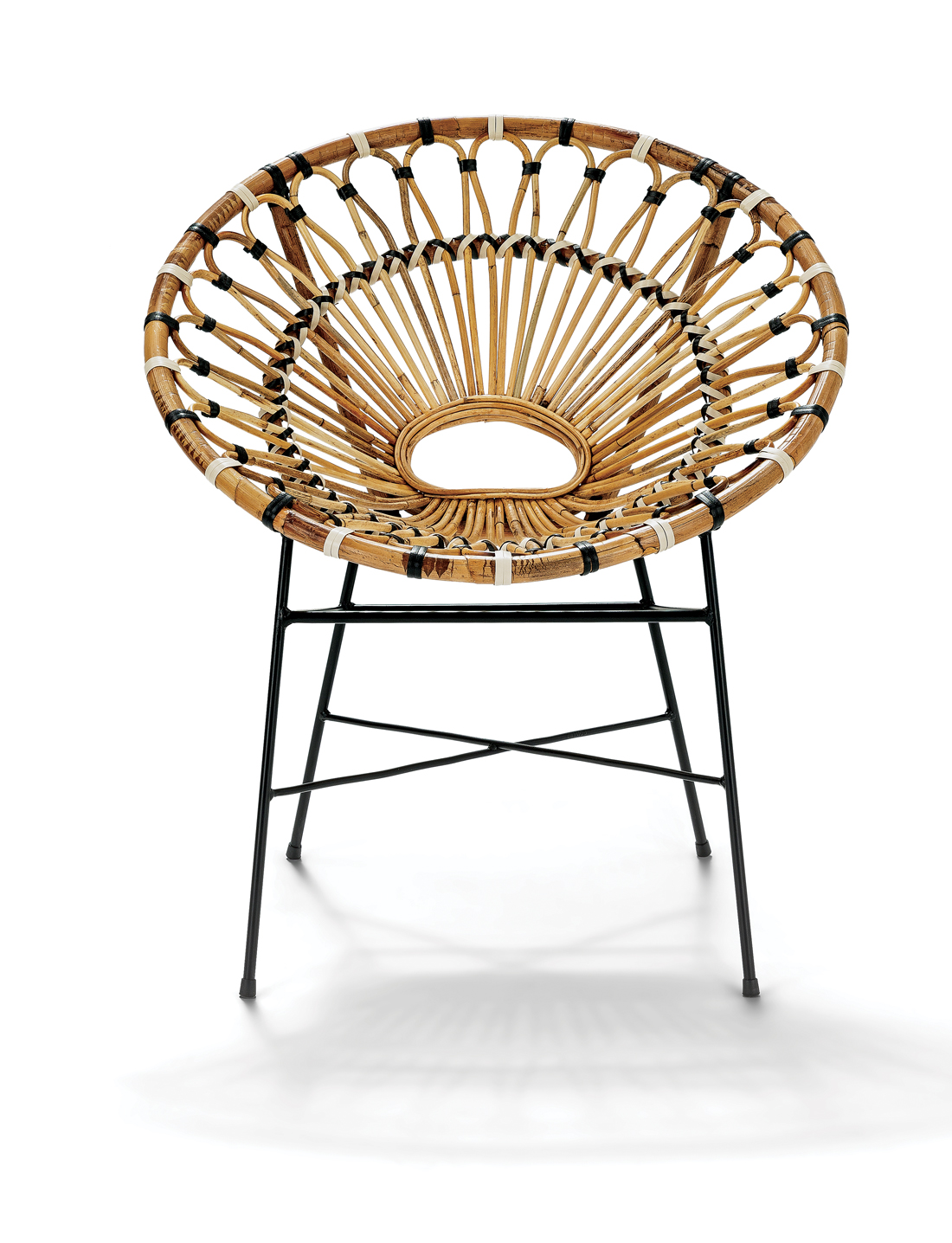 Rattan Chair on black metal legs with black and white accents.