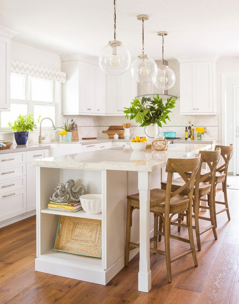 white cottage kitchen with open shelving on a white marble island