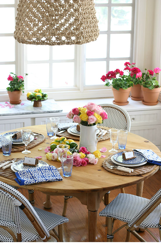 garden inspired french country table with wicker bistro chairs and rattan chargers