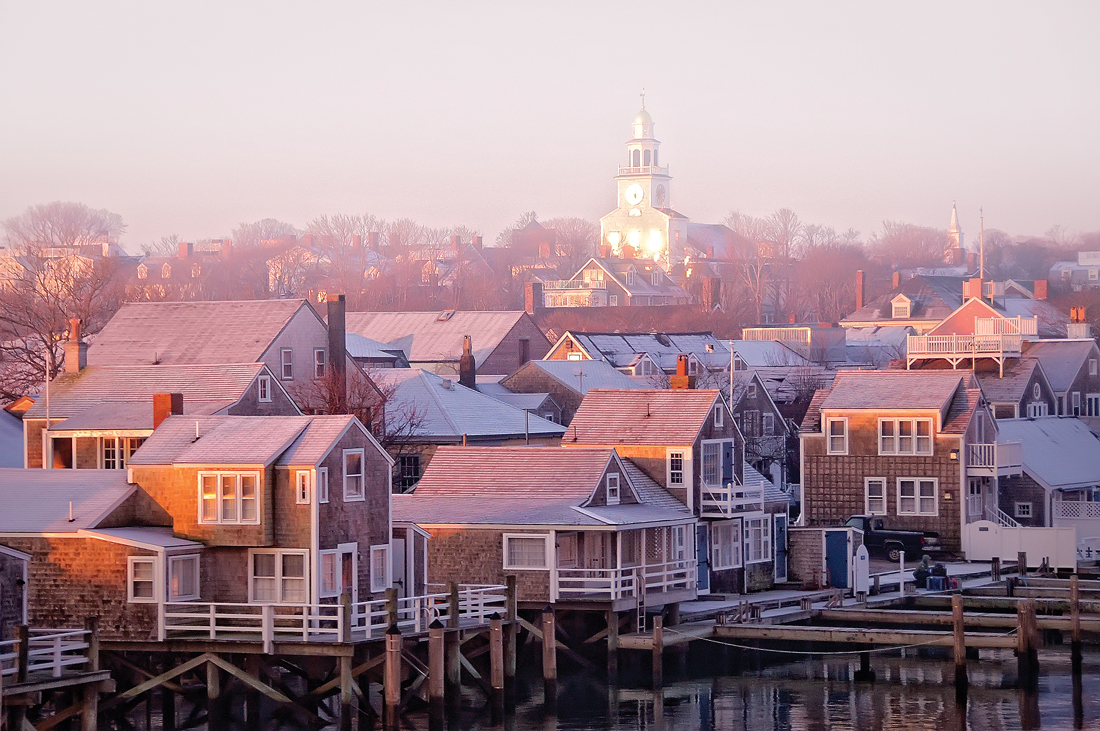 Nantucket docks and rooftops at sunrise.