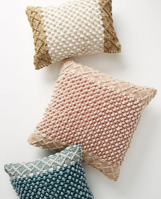 three bohemian designed throw pillows