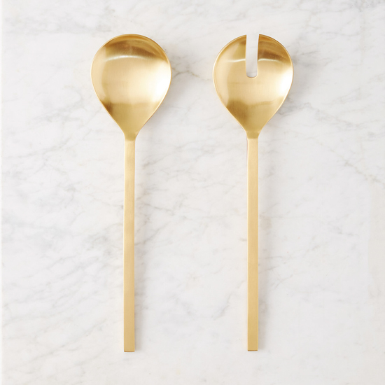 Marbled backdrop with gold salad tongs