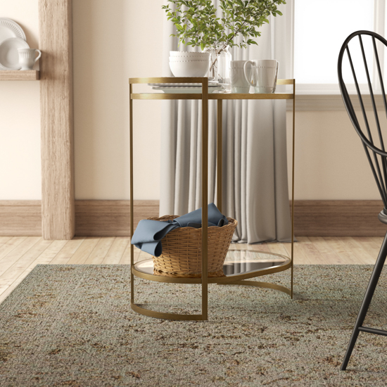 Brass bar cart displaying a basket on the bottom and drink serving ware on top