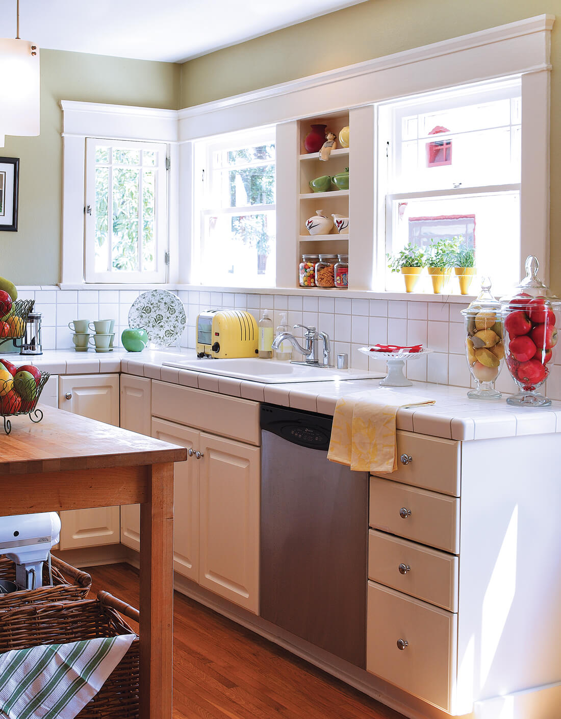 Farmhouse style kitchen with country charm and white square-tiled countertop.