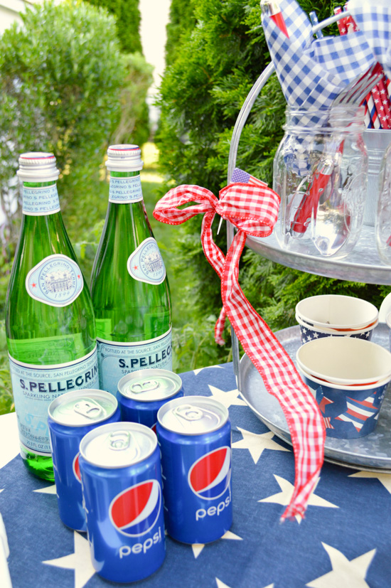 Beverages set out on a 4th of July themed side table.
