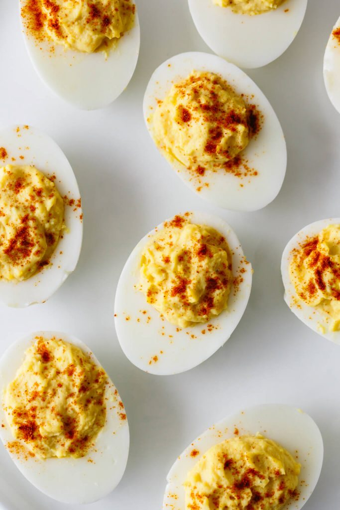 Egg yolks, mayonnaise and spices sit whipped in hard-boiled egg whites
