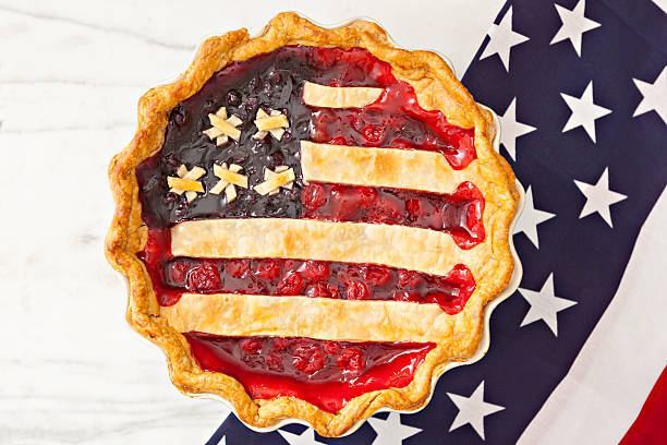 A berry pie is topped with crust arranged like an American flag