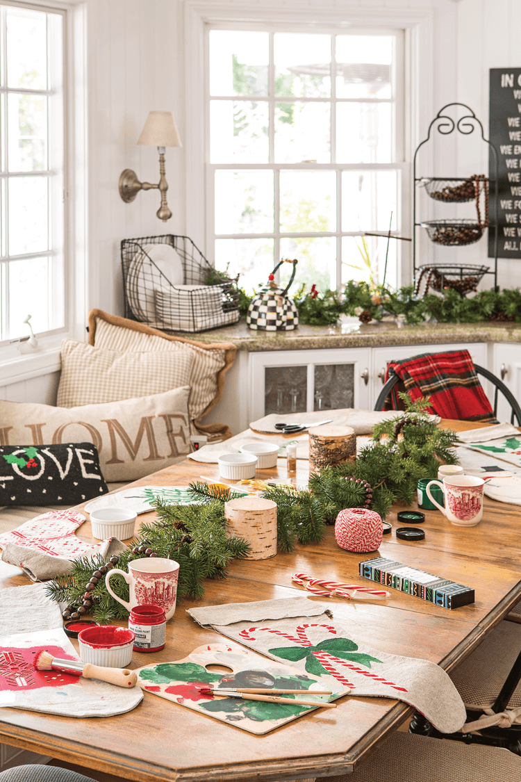 DIY Christmas stockings decorating party on a table with Christmas decorations