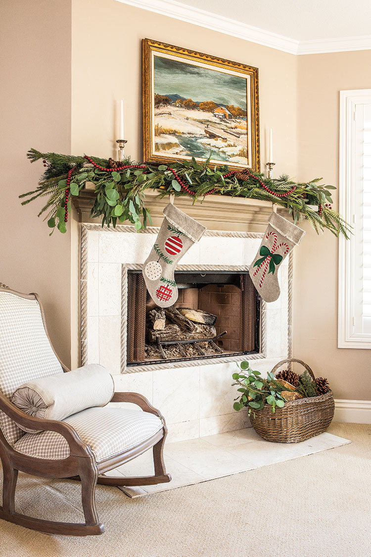 DIY Christmas Stockings hung by fireplace with rocking chair and garland