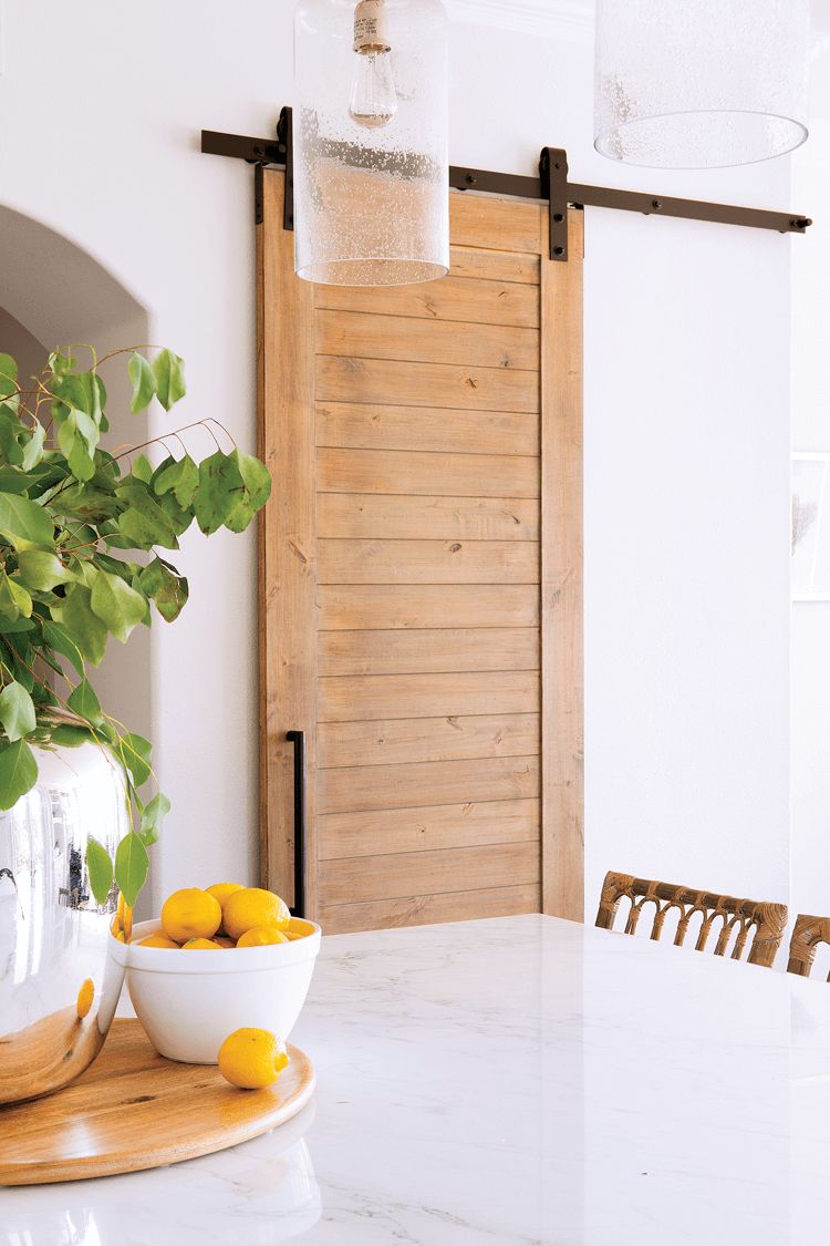 A custom made sliding barn door, crafted out of wood.
