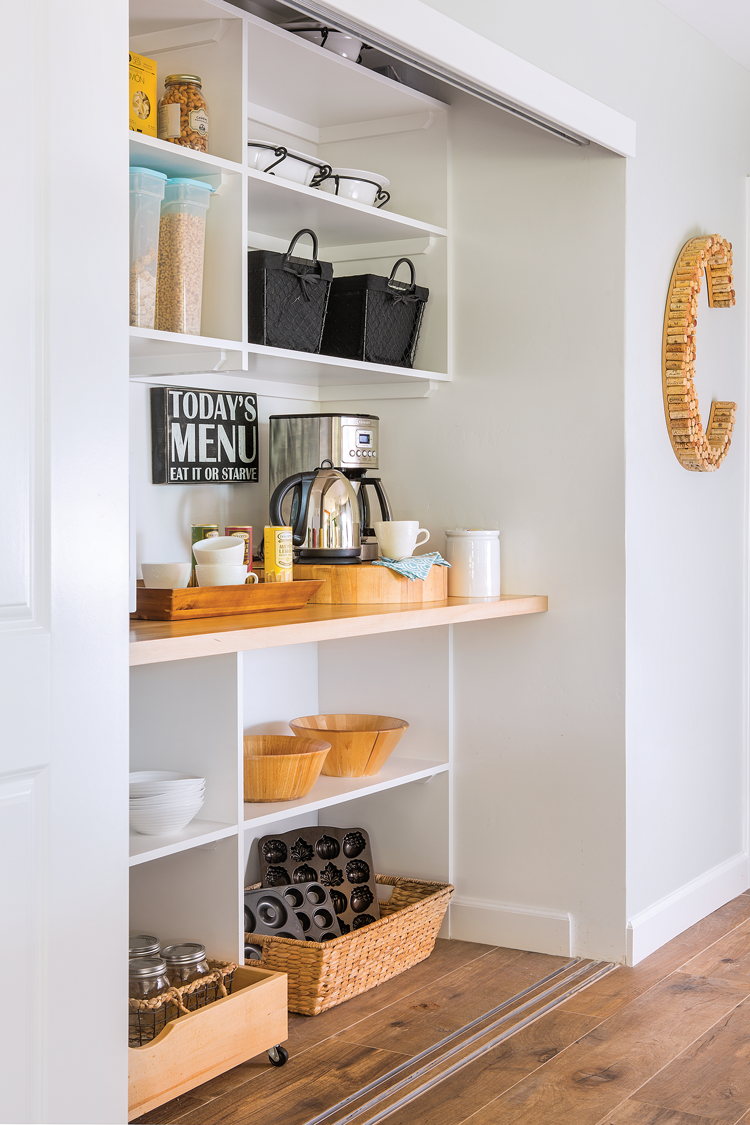 Clean and clutter-free coffee nook with open shelving and everything in it's place.