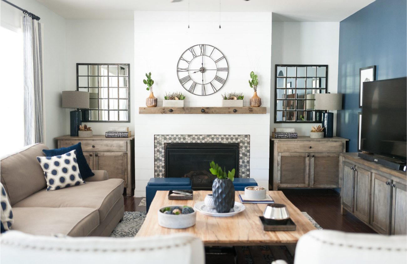 Light and bright living room, blue accent wall and rustic touches.