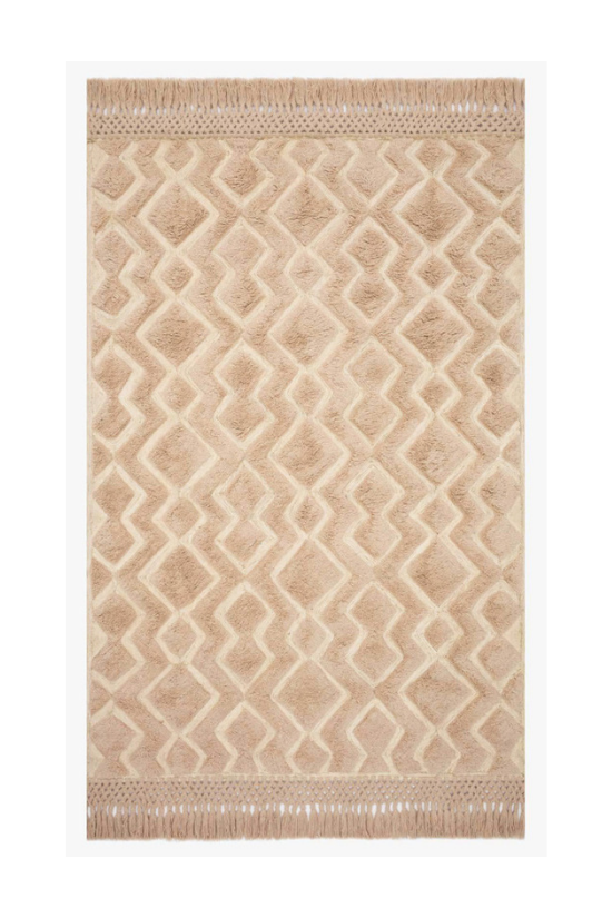 Blush colored area rug with fringed edges from the Magnolia Home Collection.