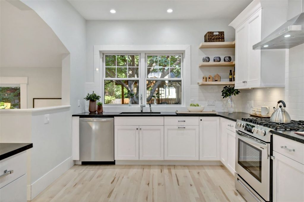 white cottage kitchen with open shelves and white oak wood floors