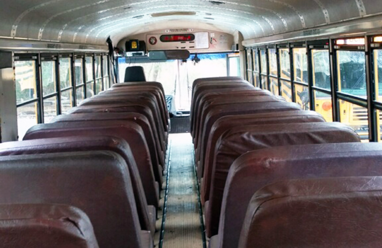 brown leather seats on school bus