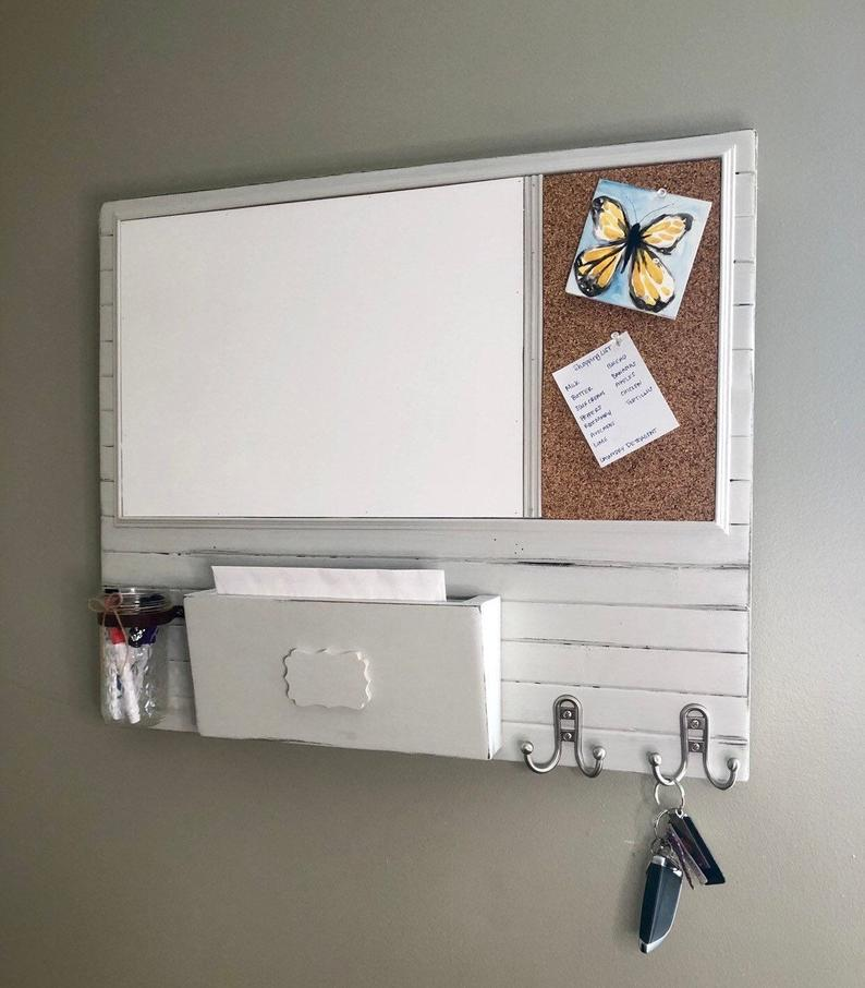 White farmhouse style dry-erase board with a place for markers, mail and keys.