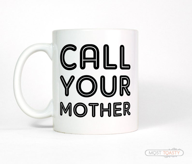 "White coffee mug that says"" call your mother"""