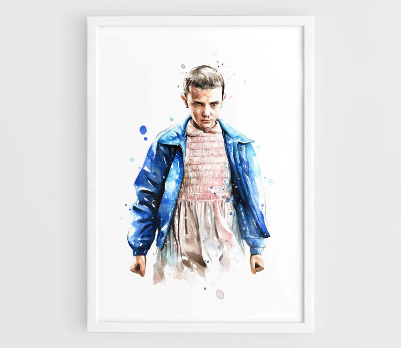 White framed art print of Eleven from Stranger Things.