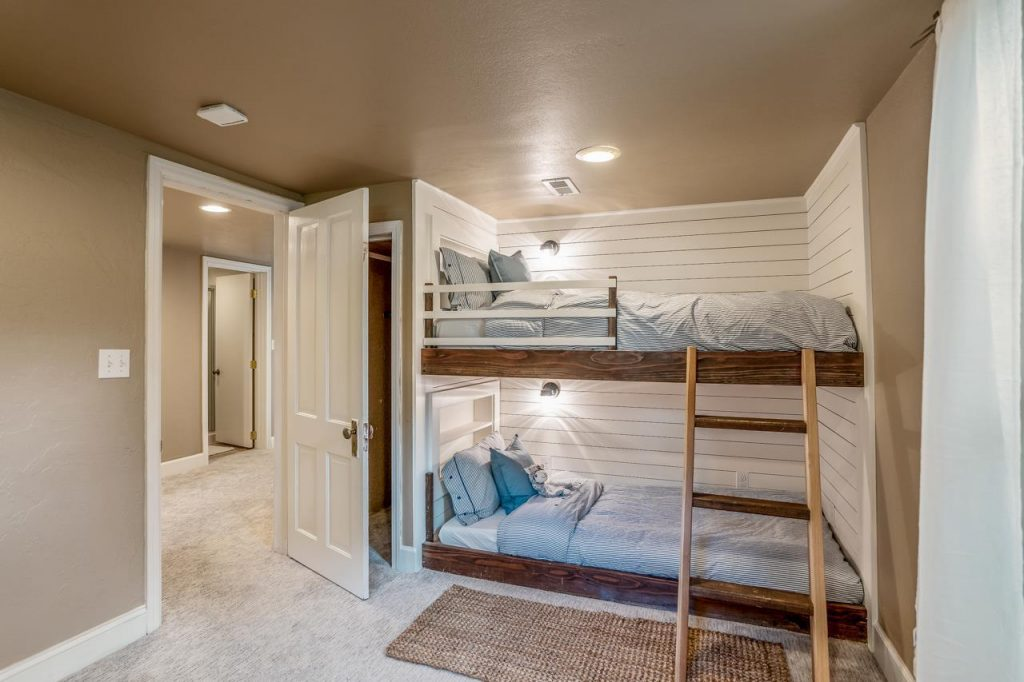 bedroom with built in bunkbed with shiplap walls