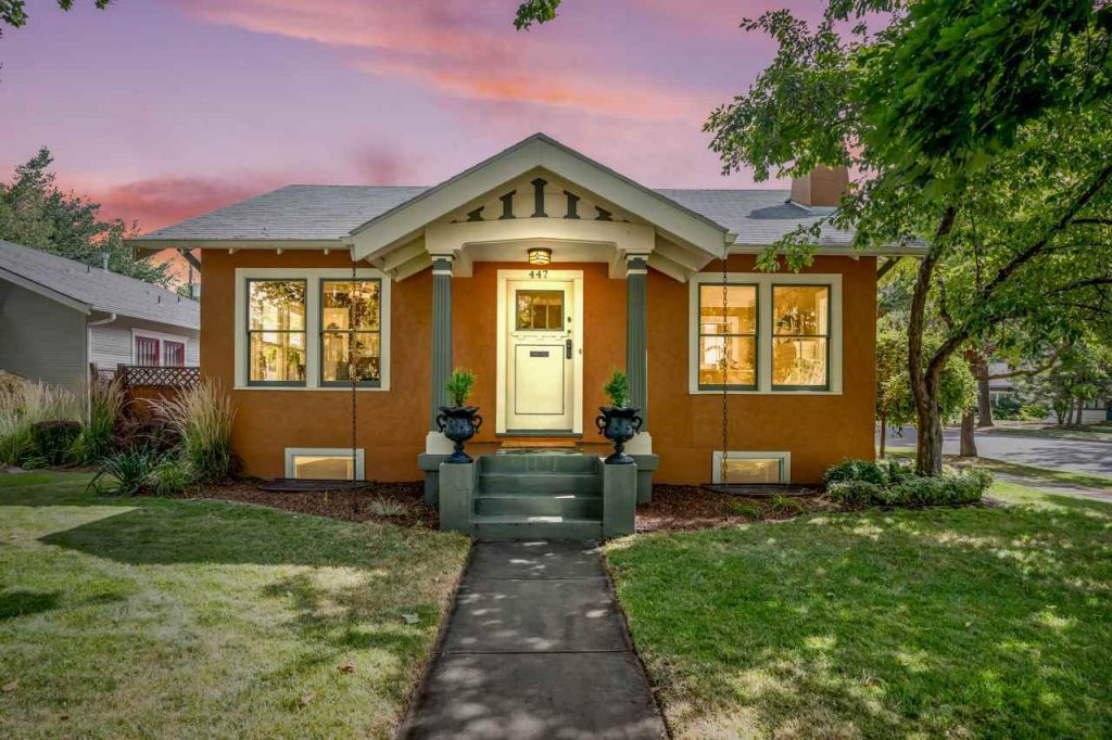 historic craftsman cottage in boise at dusk