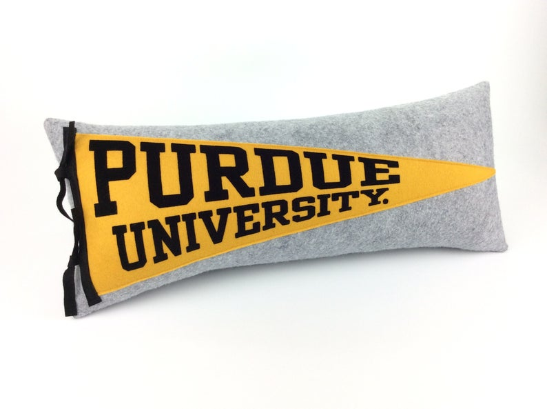 Gray and yellow pendant pillow with Purdue University on the front in yellow and black.