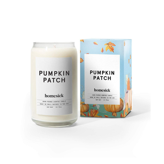 """Light blue box with a fall scene and minimalistic branding for a """"pumpkin patch"""" scented candle and the white candle with the same branding posed next to it."""