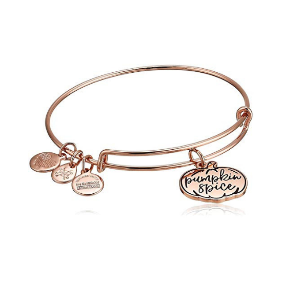 """Rose gold bangle with three small charms and one larger charm in the shape of a pumpkin with """"pumpkin spice"""" engraved on it."""